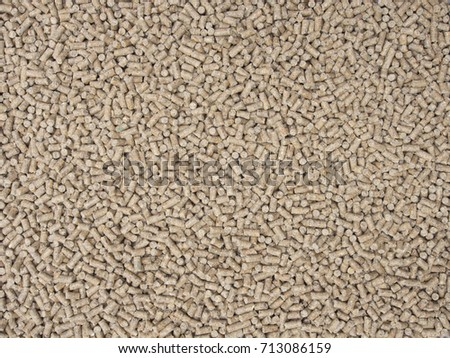 Pig feed pellets as background.