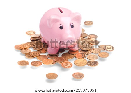 Pig-shaped money box standing on golden coins  - stock photo