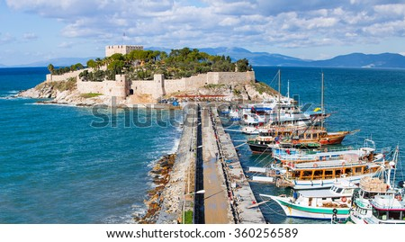 "Pigeon Island with a ""Pirate castle"". Kusadasi harbor, Aegean coast of Turkey. - stock photo"