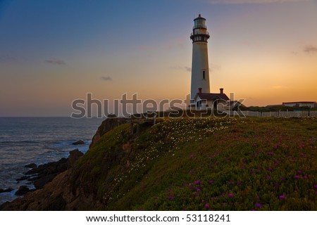 Pigeon Point Lighthouse at sunset, Pacific Ocean, California, U.S.A.  115-foot Pigeon Point Lighthouse, one of the tallest lighthouses in America, has been guiding mariners since 1872. - stock photo