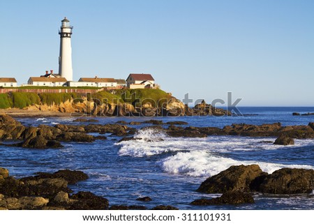 Pigeon Point Lighthouse on California Coast with Rocks and Waves - stock photo