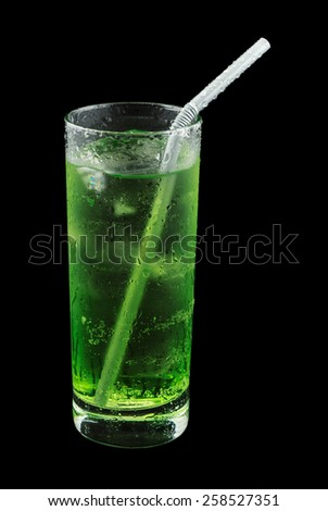 Piggelin Drink, consisting of vodka, melon liqueur and lemon-lime soda. Isolated on black background - stock photo