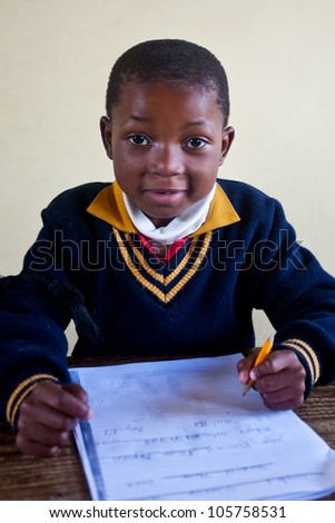 PIGGS PEAK, SWAZILAND-JULY 29: Unidentified orphan student on July 29, 2008 in Nazarene Mission School, Piggs Peak, Swaziland. Close to 10% of Swazilands population are orphans, due to HIV/AIDS. - stock photo