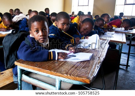 PIGGS PEAK, SWAZILAND-JULY 29: Unidentified orphan students on July 29, 2008 in Nazarene Mission School, Piggs Peak, Swaziland. Close to 10% of Swazilands population are orphans, due to HIV/AIDS. - stock photo