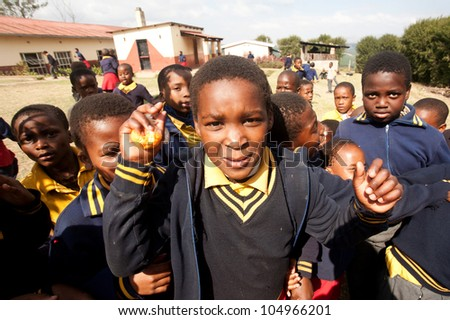 PIGGS PEAK, SWAZILAND-JULY 29: Unidentified orphan Swazi schoolboys on July 29, 2008 in Nazarene School, Piggs Peak, Swaziland. Close to 10% of Swazilands population are orphans, due to HIV/AIDS. - stock photo