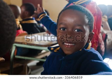 PIGGS PEAK, SWAZILAND-JULY 29: Unidentified schoolboy on July 29, 2008 in Nazarene Mission School, Piggs Peak, Swaziland. Close to 10% of Swazilands population are orphans, due to HIV/AIDS. - stock photo