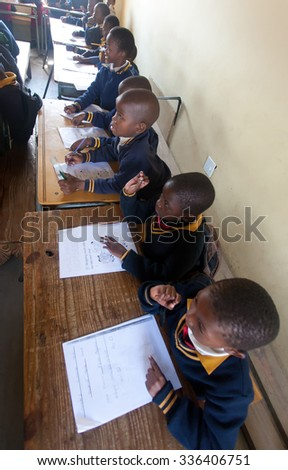 PIGGS PEAK, SWAZILAND-JULY 29: Unidentified students on July 29, 2008 in Nazarene Mission School, Piggs Peak, Swaziland. Close to 10% of Swazilands population are orphans, due to HIV/AIDS. - stock photo