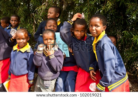 PIGGS PEAK, SWAZILAND-JULY 29: Unidentified Swazi pupils on July 29, 2008 in Nazarene Mission School, Piggs Peak, Swaziland. Close to 10% of Swaziland�s population are orphans, due to HIV/AIDS. - stock photo