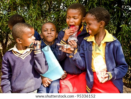 PIGGS PEAK, SWAZILAND-JULY 29: Unidentified Swazi pupils on July 29, 2008 in Nazarene Mission School, Piggs Peak, Swaziland. Close to 10% of Swaziland's population are orphans, due to HIV/AIDS. - stock photo