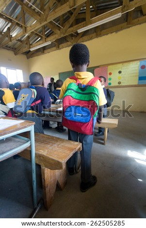 PIGGS PEAK, SWAZILAND-JULY 29: Unidentified Swazi schoolboy on July 29, 2008 in Nazarene Mission School, Piggs Peak, Swaziland. Close to 10% of the Swazi population are orphans, due to HIV/AIDS. - stock photo
