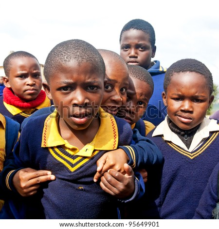 PIGGS PEAK, SWAZILAND-JULY 29: Unidentified Swazi schoolboys on July 29, 2008 in Nazarene Mission School, Piggs Peak, Swaziland. Close to 10% of Swaziland population are orphans, due to HIV/AIDS. - stock photo