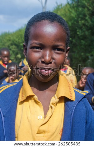 PIGGS PEAK, SWAZILAND-JULY 29: Unidentified Swazi schoolgirl on July 29, 2008 in Nazarene Mission School, Piggs Peak, Swaziland. Close to 10% of the Swazi population are orphans, due to HIV/AIDS. - stock photo