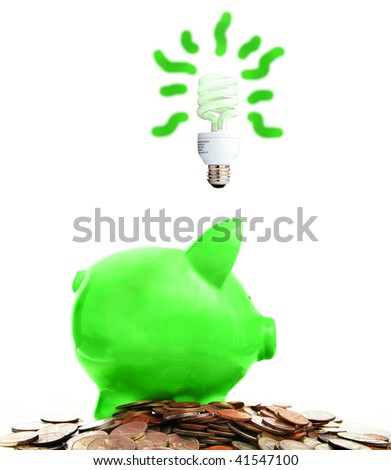 piggy bank and assorted coins with green idea, on white - stock photo