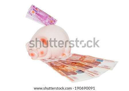 Piggy bank and banknotes - stock photo