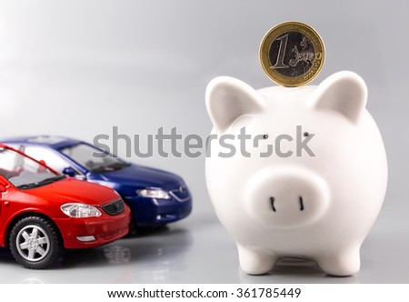 piggy bank and cars - stock photo