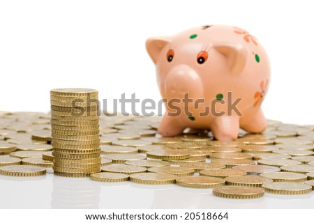 Piggy-bank and currencies with focus on first plane- Shallow DOF - - stock photo