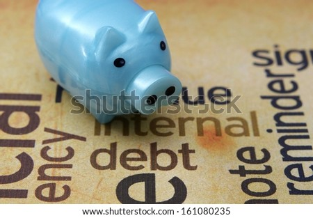 Piggy bank and debt concept - stock photo