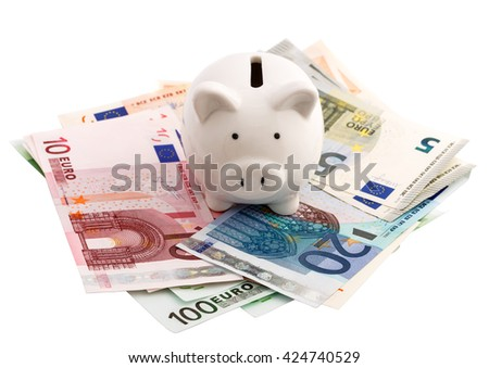 Piggy bank and euro banknotes isolated on white background - stock photo