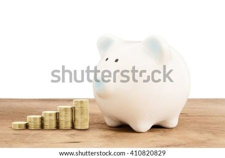 Piggy bank  and gold coin on wood floor with white background , saving banking ,family concept - stock photo