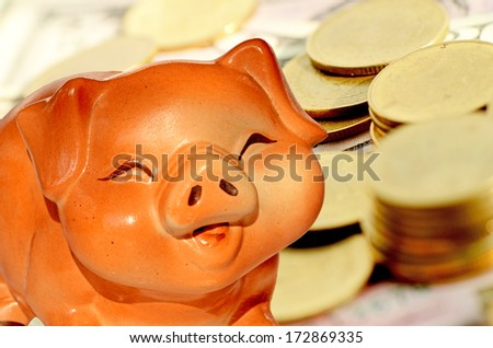 Piggy bank and gold coins background in saving money concept.