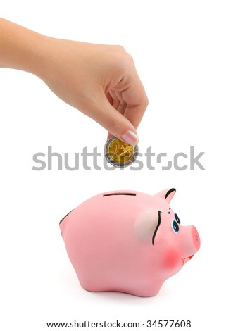 Piggy bank and hand with coin isolated on white background - stock photo