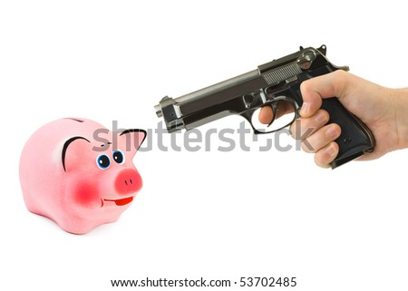 Piggy bank and hand with gun isolated on white background - stock photo