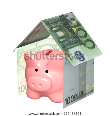 Piggy bank and house. Isolated over white