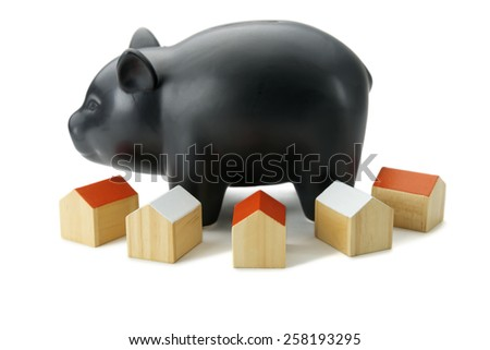 piggy bank and little house isolated on white background - stock photo