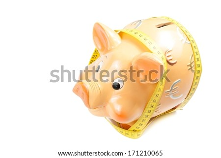 piggy bank and measure tape on white background with space for text, concept for business and save money - stock photo