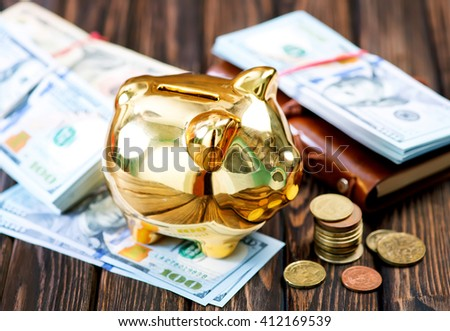 Piggy bank and money on a table - stock photo