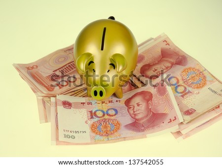 piggy bank and one-hundred rmb bill - stock photo