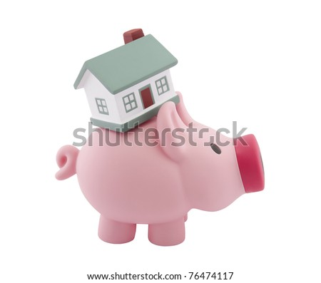 Piggy bank and small house with clipping path