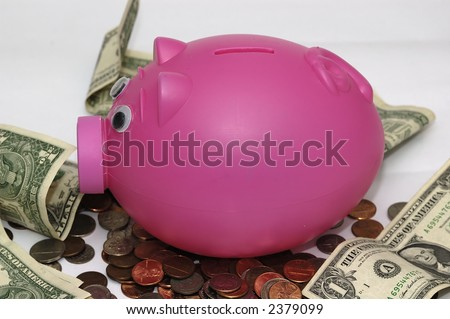 Piggy bank and some money against a white background - stock photo