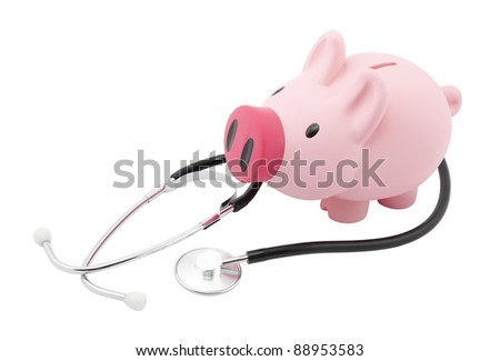 Piggy bank and stethoscope with clipping path - stock photo