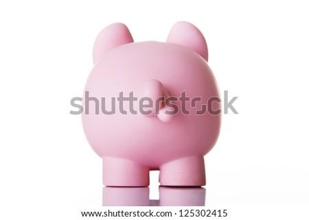 Piggy bank back. Isolated on white. - stock photo
