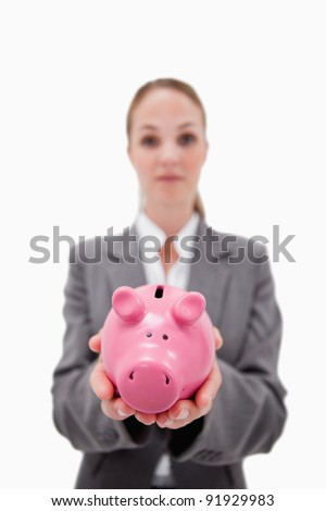 Piggy bank being held by bank employee against a white background