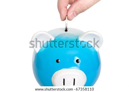 piggy bank being loaded with coins - stock photo