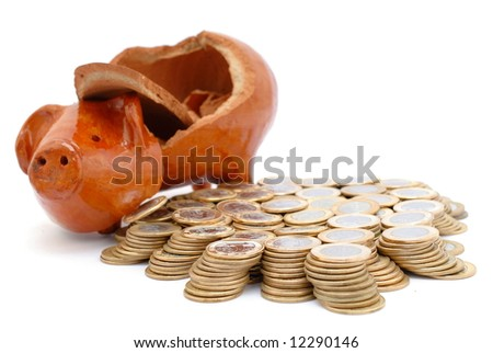 Piggy bank broken and money coins scattered across the floor. - stock photo