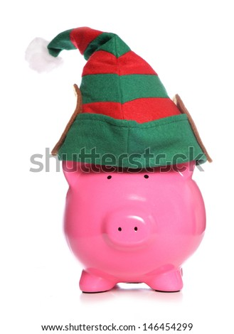 Piggy bank christmas elf studio cutout - stock photo