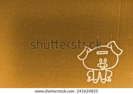 piggy bank drawn on cardboard - stock photo