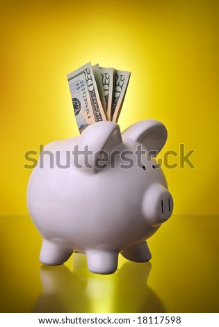 Piggy Bank Financial Investment Savings w/ Money in cash $20 bills w/ gold gradient background symbolizing retirement and investing