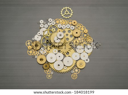 Piggy bank formed by gears and cogs - stock photo