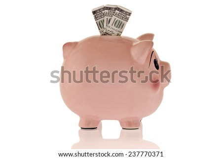 Piggy Bank From Side With Money In Slot - stock photo