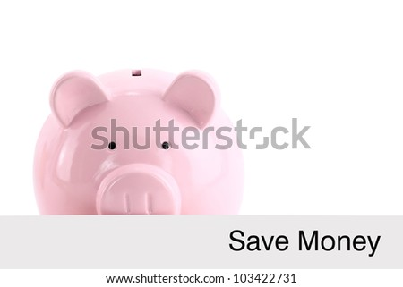 Piggy bank hiding behind a banner isolated on white - stock photo