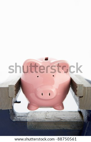 Piggy bank in a vice - stock photo