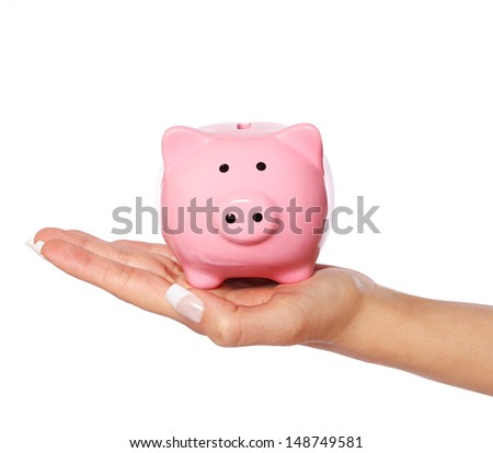Piggy bank in female hand isolated on white background. Savings - stock photo