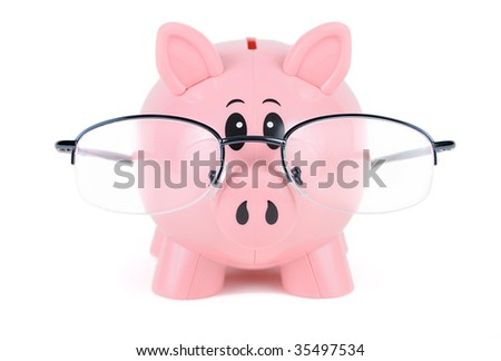 Piggy Bank in Glasses - educated piggy bank wearing glasses over white - stock photo