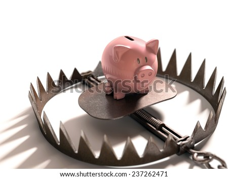 Piggy bank in the bear trap on white background. - stock photo