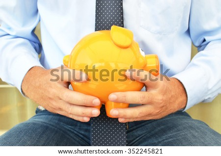 Piggy bank in the hands