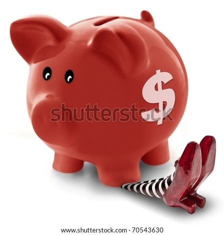 Piggy Bank landing on wicket witch - stock photo